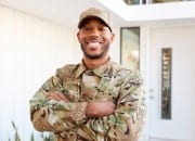 smiling-veteran-outside-house