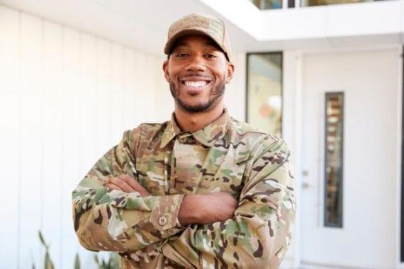 smiling-veteran-outside-house