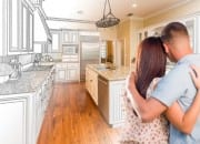 couple-looking-at-kitchen-remodel